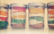 Homemade deconstructed rainbow cupcakes in a jar