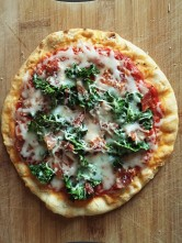 Homemade kale and prosciutto pizza