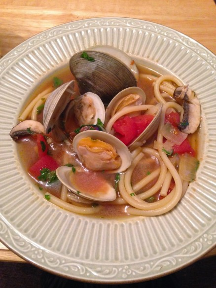 Homemade clam with tomatoes and bucatini